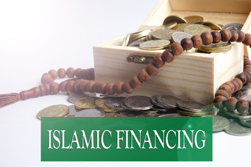 Coins in the wooden box and rosary. Islamic finance/banking concept
