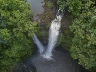 Spectacular 55-m high Fuipisia waterfall in jungle, Samoa
