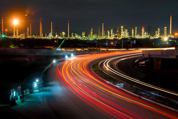beautiful lighting of oil refinery plant in heavy petrochemical industry estate use for power,Road to the oil refiner on blue sky in twilight time background