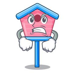 Angry wooden bird house on a pole cartoon