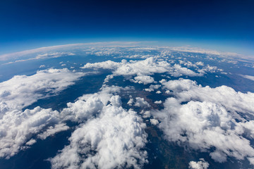 Fototapeta Curvature of planet earth. Aerial shot. Blue sky and clouds