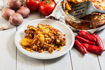 Portion of mexican potato casserole with minced meat