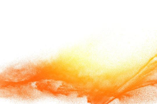 Yellow orange dust particles explosion on white background. Powder dust splash.