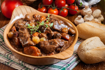 Beef Bourguignon stew served with baguette Wall mural