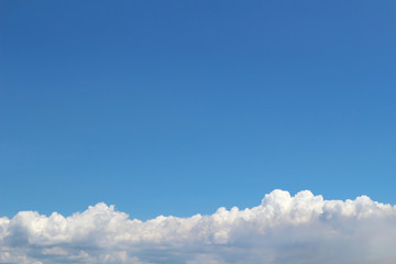 The summer cloud spreading in the blue sky
