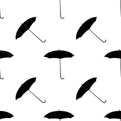 seamless pattern with the black umbrellas on a white background