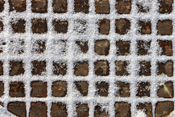 Background of the squares of flakes of snow.; Cover hatch with waffle pattern. Flakes of snow are like powdered sugar.