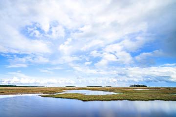River landscape with dry plains under a blue sky