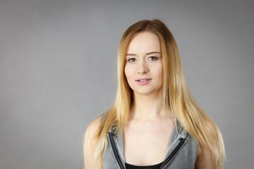 Portrait of happy blonde woman smiling
