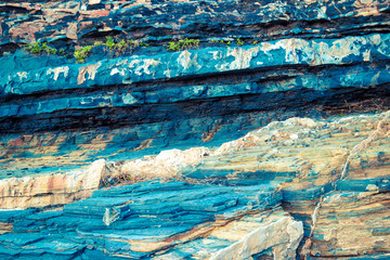 Colorful blue layers of rock. Abstract textured background