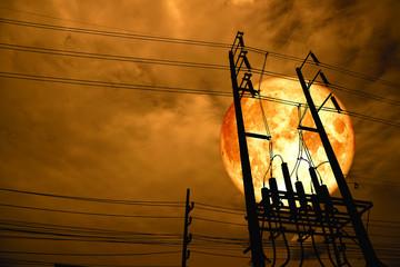 blood moon back silhouette power electric line pillar in dark night sky