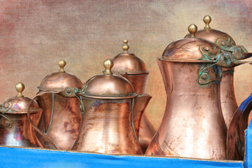 old copper pitcher on texture background