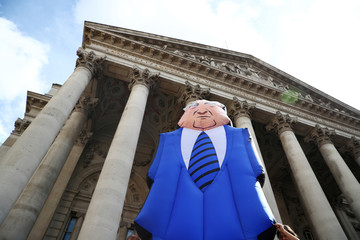 Protesters hold up a giant inflatable man in a suit and tie outside the Royal Exchange, opposite the Bank of England, before a speech by the Labour Party's shadow Chancellor of the Exchequer, John McDonnell, in London