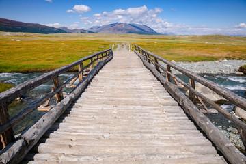 Wooden bridge in Altai Mountains Mongolia