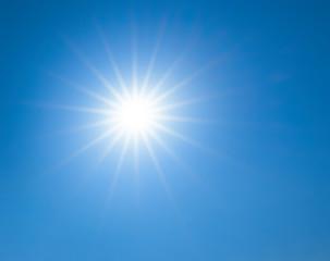sun is in a star shape on blue sky