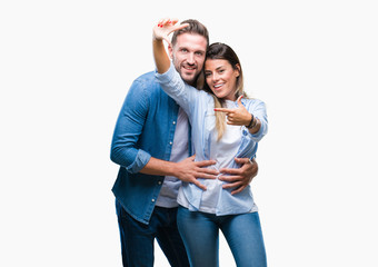 Young couple in love over isolated background smiling making frame with hands and fingers with happy face. Creativity and photography concept.