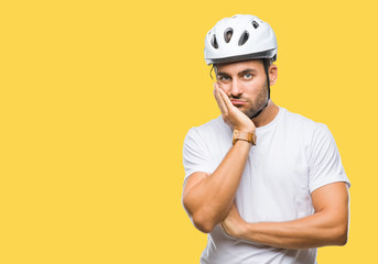Young handsome man wearing cyclist safety helmet over isolated background thinking looking tired and bored with depression problems with crossed arms.