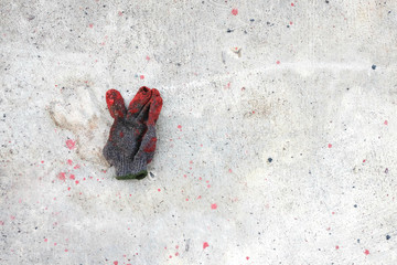 Dirty and old glove on concrete floor