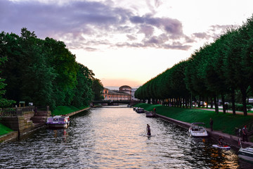 Canal or river with the garden in the evening Saint Petersburg