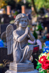 Small stone angel on a cemetery.