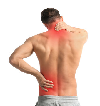 Young man suffering from neck pain on white background