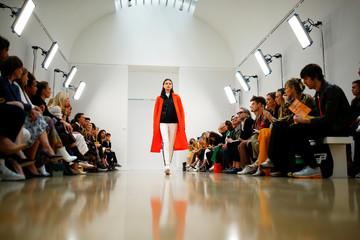 Models present creations at the Jasper Conran catwalk show at London Fashion Week Women's in London