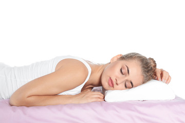 Beautiful woman sleeping with orthopedic pillow on bed against white background