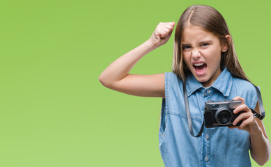 Young beautiful girl taking photos using vintage camera over isolated background annoyed and frustrated shouting with anger, crazy and yelling with raised hand, anger concept