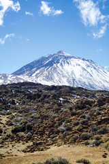 View of El Teide from the north side. Snowy and covered in clouds. Tenerife, Canary Islands