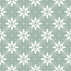 Vector vintage design Christmas Stylized white Snowflakes on a green Background. Seamless pattern.