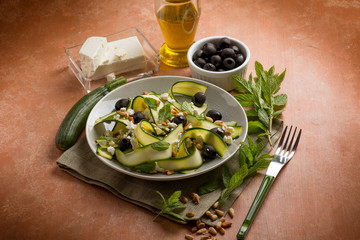 grilled zucchinis salad with feta cheese and olives