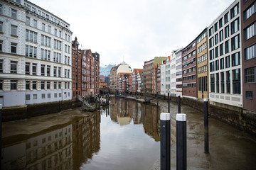 Colorful buildings reflecting on a canal in Hamburg, Germany