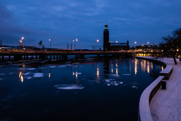 stockholm city hall and bridge at night during winter