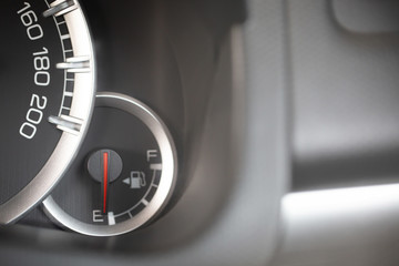 close up image of a car's fuel gauge meter.  fuel level gauges on a car's dashboard and Car need fuel.