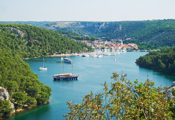 Skradin city and bay with ships and yachts in Croatia.