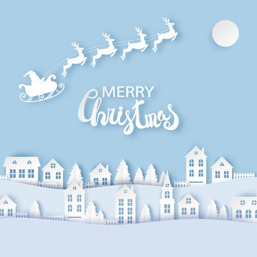 Winter urban countryside landscape village with cute paper houses, pine trees and Santa with deers flying in the sky. Merry Christmas and New Year paper art background