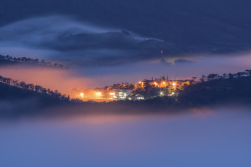Long exposure with magic of the fog cover town and light at night, artwork of the landscape nature, pictures used in the design, advertising, travel, printing with hight quality