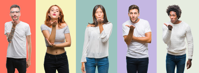 Composition of african american, hispanic and chinese group of people over vintage color background looking at the camera blowing a kiss with hand on air being lovely and sexy. Love expression.