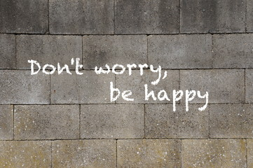 The words Don't Worry Be Happy painted on a wall.
