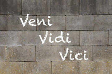 The words Veni Vidi Vici painted on a wall.