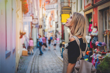 Young lady in dress on medieval street of Bremen, Germany. Trevel destination concept Fototapete