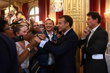 French President Emmanuel Macron shakes people's hands as visitors are allowed access to the Elysee Palace in Paris