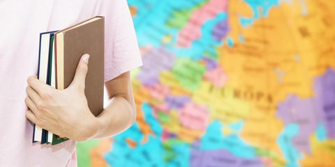 student hand with books and map, learn languages