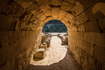 Entrance tunnel from where the athletes enter to the ancient Panhellenic stadium at archaeological site of Nemea in Greece