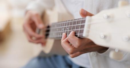 Woman play ukulele