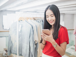 Young woman happy with by smartphone. Easy E-commerce Website Shop by Smartphone.