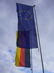 Flag of Europe along with flag of Germany. Transparent EU flag against German flag.