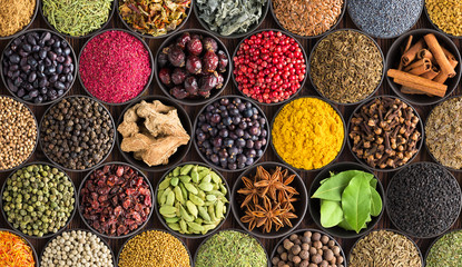 Fototapete - colorful spice background, top view. Seasonings and herbs for Indian food