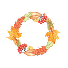 Watercolor wreath of autumn leaves and berries on a white background