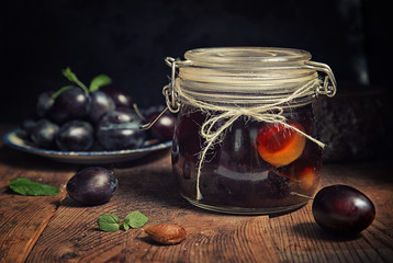 Plum compote in jar